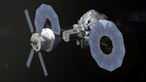 Το διαστημικό σκάφος Orion της NASA πλησιάζει το ρομποτικό όχημα σύλληψης του αστεροειδούς. Ο αστεροειδής είναι παγιδευμένος στο πλαστικό περίβλημα.