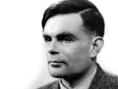 O Alan Turing (δεξιά) με  συνεργάτες του εργάζεται στον υπολογιστή  Ferranti Mark