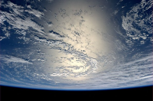 Earth_glinting_in_the_sun_node_full_image_2