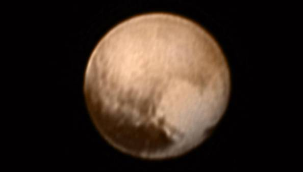 This image of Pluto from New Horizons' Long Range Reconnaissance Imager (LORRI) was received on July 8, and has been combined with lower-resolution color information from the Ralph instrument. Credits: NASA-JHUAPL-SWRI